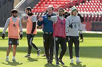 Toronto, ON, Canada - Friday Dec. 09, 2016: Brian Schmetzer, Herculez Gomez, Erik Friberg during training prior to MLS Cup at BMO Field.