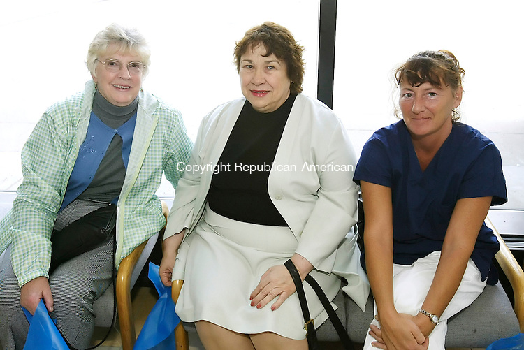 WATERBURY, CT, 10 May 2006- 051006BZ13- From left- Kathi Kelly (CQ), of Southbury, R.N., Southbury Training School; Rose Rossignol, of Oakville, R.N., Pomperaug Woods; and Deana Visponi, of Naugatuck, student nurse;<br /> <br /> during a program titled &quot;Nurses Lead The Way&quot; sponsored by The Greater Waterbury Nursing Consortium at Naugatuck Valley Community College in Waterbury Wednesday afternoon.  <br />  Jamison C. Bazinet Republican-American