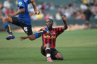 Edgard Castillo (left) jumps over Shaun Wright-Phillips (right) after the tackle. Manchester City defeated Club America 2-0 in the Herbalife World Football Challenge 2011 at AT&T Park in San Francisco, California on July 16th, 2011.
