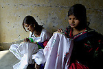Girls who work as domestic servants get off-hour training in embroidery and basic literacy skills at a Church of Pakistan-sponsored program in the Punjab village of Chuhang. .