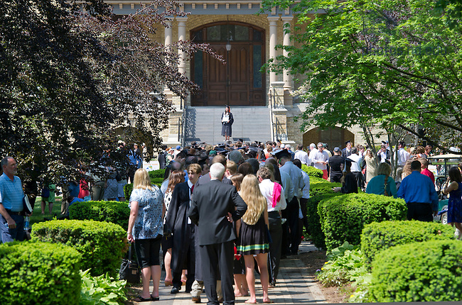 May 19, 2013; Graduates pose for photos on the steps of the Main Building after the 2013 Commencement. Photo by Barbara Johnston/University of Notre Dame
