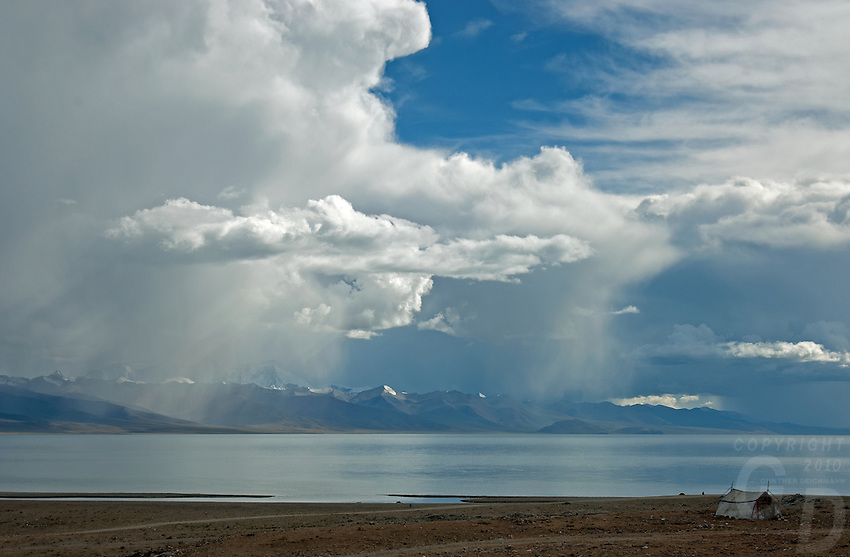 Tibet Lake Namtso which is the highest saltwater lake in the world at an elevation of 4870 meters. The snow-covered Mountain range just behind the lake reach over 7500 meters.