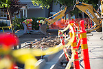 Orange cones and yellow tape mark the continuing sidewalk construction work occurring on First Street in downtown Los Altos.