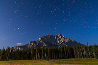 The Big Dipper and Arcturus (at left) over Cascade Mountain in Banff National Park, Alberta. Taken July 29, 2012 with Canon 5D MkII and 16-35mm lens for 48s at f/4 and ISO 800. Moonlight from waxing gibbous Moon (off camera) provides the illumination. Taken on meadows near Johnson Lake turnoff on Lake Minnewanka loop road.