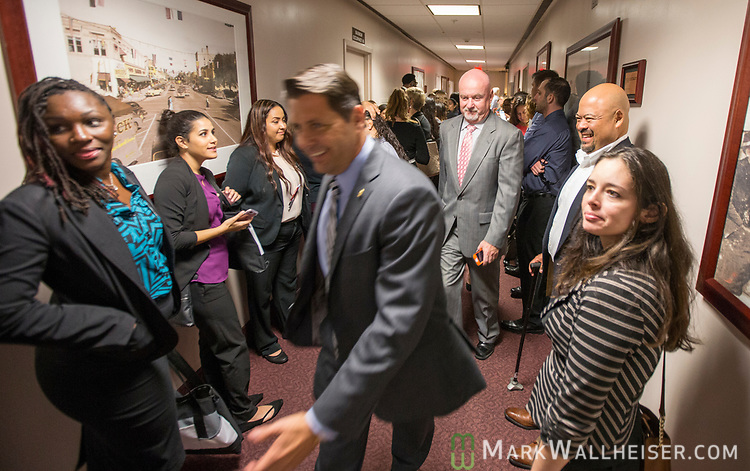 Legislators and lobbyist cut through the crowd waiting to get inside House 333 for a press conference on military-friendly legislation held by Rep. Paul Renner at the Florida Capitol.