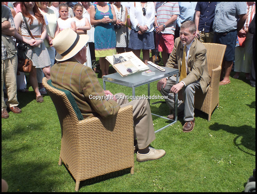 BNPS.co.uk (01202 558833)<br /> Pic: AntiquesRoadshow/BNPS<br /> <br /> ***Please Use Full Byline***<br /> <br /> Roy Wooldridge (left) with Arms and Militaria specialist Graham Lay on Antiques Roadshow. The episode will air this Sunday (23/11/14). <br /> <br /> The incredible story of how legendary German general Erwin Rommel spared the life of a captured British soldier and then served him a glass of beer has been revealed after 70 years.<br /> <br /> Captain Roy Wooldridge met Rommel after being taken prisoner in a dangerous night-time mission to examine submerged mines along the French beaches weeks before the D-Day landings.<br /> <br /> His story is to be told on BBC1's Antiques Roadshow this Sunday.