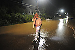 Emergency Management director Jimmy Allgood looks over water Chandler Avenue floods following heavy rainfall in Oxford, Miss. on Sunday, May 16, 2010.