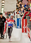 5 December 2015: Emily Sweeney, competing for the United States of America, is elated as she carries her sled off the track after her second run of the Viessmann World Cup Women's Luge, with a combined 2-run time of 1:28.136 and a 2nd place result at the Olympic Sports Track in Lake Placid, New York, USA. Mandatory Credit: Ed Wolfstein Photo *** RAW (NEF) Image File Available ***