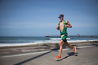 Trevor Wurtele competes during the run portion of the Accenture Ironman California 70.3 in Oceanside, CA on March 29, 2014.