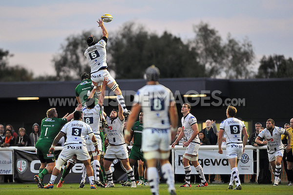 Mark Sorenson rises high to win lineout ball. Pre-season friendly match, between London Irish and Bristol Rugby on August 22, 2014 at Hazelwood in Middlesex, England. Photo by: Patrick Khachfe / JMP