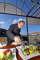 Expert waiter serving fish in a high class restaurant, Ibiza, Spain Photo by Nano Calvo - VWPics