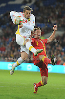 Cardiff City Stadium, Friday 11th Oct 2013. Andy King of Wales battles with Agim Ibraimi of Macedonia during the Wales v Macedonia FIFA World Cup 2014 Qualifier match at Cardiff City Stadium, Cardiff, Friday 11th Oct 2014. All images are the copyright of Jeff Thomas Photography-07837 386244-www.jaypics.photoshelter.com