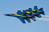 The Blue Angels in echelon formation make a pass down the crowd line during the 2005 Lemoore Air Show at Lemoore Naval Air Station in California. Lemoore Naval Air Station is located southwest of Fresno, California and is the primary Naval Air Base on the West Coast. The Blue Angels fly the Boeing built F/A-18 Hornet. Photographed 03/05
