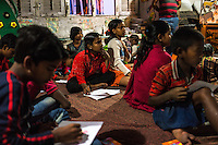 Boatmen's children during an art class in the Boat School Guria runs on the holy Ganges River, in Varanasi, Uttar Pradesh, India on 11 November 2013. The school aims to take the boatmen's children away from working in the tourist areas where they are exposed to trafficking and sexual abuse.