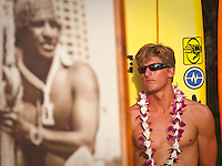 Defending Champion Bruce Irons (HAW) HALEIWA, HI Dec. 1, 2005 The opening ceremony of the Quiksilver in Memory of Eddie Aikau was held today at Waimea Bay. This year's event  will be held on one day , between December 1, 2005 and February 28, 2006, when the waves eceed the  20 foot  minimum threshold and the 28 invitees will compete for the $98.000 prize purse...The northern hemisphere winter months on the North Shore signal a concentration of surfing activity with some of the best surfers in the world taking advantage of swells originating in the stormy Northern Pacific. Notable North Shore spots include Waimea Bay, Off The Wall, Backdoor, Log Cabins, Rockpiles and Sunset Beach... Ehukai Beach is more  commonly known as Pipeline and is the most notable surfing spot on the North Shore. It is considered a prime spot for competitions due to its close proximity to the beach, giving spectators, judges, and photographers a great view...The North Shore is considered to be one the surfing world's must see locations and every December hosts three competitions, which make up the Triple Crown of Surfing. The three men's competitions are the Reef Hawaiian Pro at Haleiwa, the O'Neill World Cup of Surfing at Sunset Beach, and the Billabong Pipeline Masters. The three women's competitions are the Reef Hawaiian Pro at Haleiwa, the Gidget Pro at Sunset Beach, and the Billabong Pro on the neighboring island of Maui...Photo: Joliphotos.com