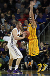 Northern Iowa's Jeremy Morgan (20) looks to pass against Wyoming's Larry Nance (22 ) 2015 NCAA Division I Men's Basketball Championship March 20, 2015 at the Key Arena in Seattle, Washington.   Northern Iowa beat Wyoming 71 to 54.   ©2015.  Jim Bryant Photo. All Rights Reserved.