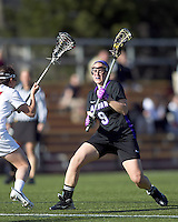 University at Albany midfielder Rachael Burek (9) on the attack. University at Albany defeated Boston College, 11-10, at Newton Campus Field, on March 30, 2011.