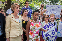 Democratic NYS gubernatorial candidate Zephyr Teachout, lef,t with NOW-NYS Pres. Zenaida Mendez, speaks at a news conference in New York on Tuesday, August 26, 2014  about receiving the endorsement of the National Organization of Women-NYS in her candidacy for governor of New York State. Teachout, a Fordham University law professor is considered a long shot in the Democratic primary on Sept. 9 against well-funded incumbent Gov. Andrew Cuomo but supporters encourage voters to cast their ballot as a vote against Cuomo. The event was held at the Eleanor Roosevelt statue in Riverside Park on Women's Equality Day. (© Richard B. Levine)