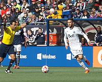 Vancouver Whitecaps FC substitute midfielder Pedro Morales (77) dribbles. In a Major League Soccer (MLS) match, the New England Revolution (blue/white) tied Vancouver Whitecaps FC (white), 0-0, at Gillette Stadium on March 22, 2014.