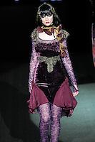 Jandra walks runway in a My Girl outfit, from the Betsey Johnson Fall 2011 He Loves Me Not - Black Tag collection, during Mercedes-Benz Fashion Week Fall 2011.