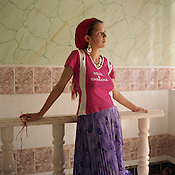 "A young married Roma girl, 14 years old Gradina Badea, known to her family as ""Taliban"" due to her dark skinned looks, stands in the house where she lives with her extended family, in the Roma camp of Sintesti.."