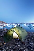 Icebergs and sea kayaker's camp on edge of Sermilik Fjord near settlement of Tiniteqilaq, East Greenland