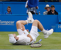Andy Murray falls during a tennis match which he won agains Kyle Edmund of New Zealand, at Aegon Queens Tennis Championship June 17, 2016 in London England.<br /> CAP/GOL<br /> &copy;GOL/Capital Pictures /MediaPunch ****NORTH AND SOUTH AMERICAS ONLY***