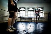 Warsaw 04.2009 Poland<br /> Young boksers jumping on the skipping-rope.<br /> Since the early 50' ties &quot;Gwardia&quot; has been famous for bringing up world boxing champions. The famed sports hall located by pl. Zelaznej Bramy in Warsaw witnessed trainings of Jerzy Kulej, the Skrzeczowie brothers, last Polish olympic champion Jerzy Rybicki or its most recent star Krzysztof &quot;Diablo&quot; Wlodarczyk. The club prides of numerous sport achievements, among others, 15 olympic medals (6 gold), over 60 medals from European and World Championships and over 100 from Championships of Poland.<br /> Today, only three small training halls remain from the former times of glory.<br /> One of the most famous in Polish history boxing section of Warsaw's &quot;Gwardia&quot; awaits its liquidation. This &quot;Mecca&quot; of Polish boxing is to be replaced by a huge supermarket,  decisions imposed by Warsaw authorities.<br /> ( Photo: Adam Lach / Napo Images )<br /> <br /> Juz od wczesnych lat 50. Gwardia slynela z wychowywania swiatowych mistrzow bokserskich. W hali przy pl. Zelaznej Bramy trenowali Jerzy Kulej, bracia Skrzeczowie, ostatni polski mistrz olimpijski w boksie Jerzy Rybicki czy obecna gwiazda ringu Krzysztof &quot;Diablo&quot; Wlodarczyk. Klub moze poszczycic sie wieloma osiagnieciami sportowymi, do kt&oacute;rych przede wszystkim zaliczyc nalezy: 15 medali olimpijskich (w tym 6 zlotych), ponad 60 medali Mistrzostw Swiata i Europy i ponad 1000 medali Mistrzostw Polski. Teraz z dawnej swietnosci pozostaly zaledwie trzy male salki. Jedna z najslyniejszych w historii Polski sekcja bokserska Gwardii Warszawa ma byc zlikwidowana. Decyzja wladz Warszawy, te swego rodzaju mekke polskiego boksu ma zastapic wielki market<br /> (Fot Adam Lach / Napo Images )