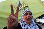A Palestinian woman marks victory sign during a rally in Gaza city on December 31, 2012. The Gaza branch of Palestinian president Mahmud Abbas's Fatah party said on Friday it will mark its anniversary in the Hamas-ruled enclave after an accord between the two factions. Photo by Ezz al-Zanoon