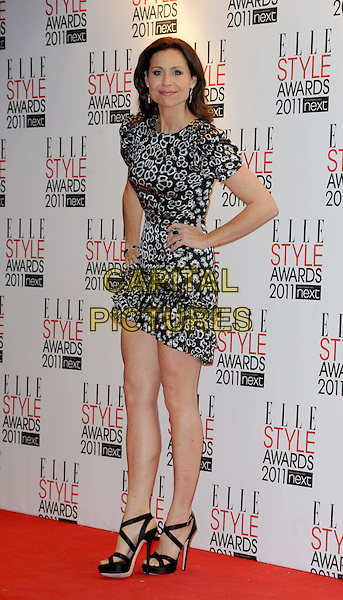MINNIE DRIVER .The ELLE Style Awards 2011 at Grand Connaught Rooms, London, England..February 14th, 2011 .full length dress hands on hips black white print .CAP/WIZ.© Wizard/Capital Pictures.