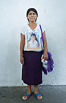Lidia Diego holds a photo of her daughter Nora Morales Diego during a vigil in Tapachula, Mexico, on December 17, 2013. The Guatemalan woman was part of a group of Central Americans who came to Mexico in search of family members who disappeared there, many while on their way north to the United States. The group, mostly mothers looking for their children, spent 17 days touring 14 Mexican states in search of their loved ones.