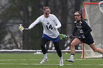 01 March 2015: Duke's Taylor Trimble (14) and Notre Dame's Alex Dalton (12). The Duke University Blue Devils hosted the University of Notre Dame Fighting Irish on the West Turf Field at the Duke Athletic Field Complex in Durham, North Carolina in a 2015 NCAA Division I Women's Lacrosse match. Duke won the game 17-3.