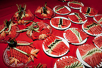 Plates of watermelon waiting to be served for desert at The West Lake Restaurant. Able to seat up to 5,000 people at one sitting, The West Lake Restaurant is the biggest Chinese restaurant in the world. Each week its diners, who staff are taught are 'the bringers of good fortune', devour 700 chickens, 200 snakes, 1,200 kgs of pork and 1,000 kgs of chillis. Its 300 chefs cook in five kitchens and its staff total more than 1,000.It is fully booked most nights.