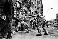 Bronx, New York City, NY. July 20th 1972. <br /> Members of the New York street gang Savage Skulls. The trademark of the, primarily Puerto Rican, gang was a sleeveless denim jacket with a skull and crossbones design on the back. Based around Fox Street, in the popular South Bronx neighborhood, the gang declared war on the drug dealers that operated in the area. Running battles were frequent with rival gangs Seven Immortals, and Savage Nomads.