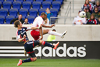 Thierry Henry (14) of the New York Red Bulls shoots and scores during the first half against the New England Revolution during a Major League Soccer (MLS) match at Red Bull Arena in Harrison, NJ, on April 28, 2012.