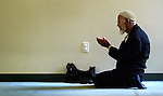 Worshipper Azimuddin participates in a prayer service at Beaverton's Bilal Mosque as part of the Muslim daily ritual....KEYWORDS: foregn relations