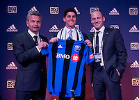 #5 overall pick Eric Miller of the Montreal Impact stands with head coach Frank Klopas (left) on the podium during the MLS SuperDraft at the Pennsylvania Convention Center in Philadelphia, PA, on January 16, 2014.