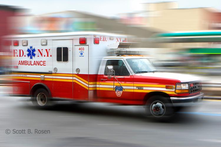New York City Fire Department Ambulance speeding through the streets, Brooklyn, New York