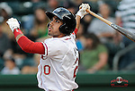 Third baseman Carlos Asuaje (20) of the Greenville Drive bats in a game against the Asheville Tourists on Monday, April 21, 2014, at Fluor Field at the West End in Greenville, South Carolina. Greenville won, 8-3. (Tom Priddy/Four Seam Images)