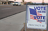 """Apache Junction, Arizona. November 6, 2012 - A bilingual """"Vote Here"""" sign on a sidewalk next to Precinct 44 at a Moose Lodge chapter building in Apache Junction, Arizona directs voters to a poll place for the Nov. 6 election. Photo by Eduardo Barraza © 2012"""
