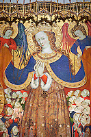 Gothic Catalan altar piece depicting the Madonna of Mercy by Bonant Zaortiga, circa 1430-1440, tempera and gold leaf on wood, from the church of Mare de Dieu de Carrasca , Blancas, Terol, Spain<br /> Bonnat Zaortiga was one of the most prominent representatives of the international Gothic. The Mother of God of Mercy  protects humans with her cape, symbolising one of the most feared evils of the European Middle Ages, plague, often understood as a punishment for the sins of mankind. This was the central panel of the altarpiece of the church of the Mother of God. National Museum of Catalan Art, Barcelona, Spain, inv no: MNAC 3945.