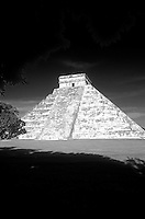 El Castillo or Pyramid of Kukulcan framed by trees, Chichen Itza, Yucatan, Mexico