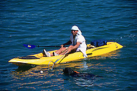 SAN FRANCISCO, CA - A fan in a kayak grabs a Barry Bonds home run ball away from a Portuguese Water Dog with a net in McCovey Cove outside of Pacific Bell Park, home of the San Francisco Giants, in San Francisco, California in 2000. Photo by Brad Mangin