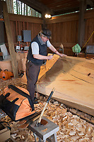 Carvers create a 27 foot Northern Ceremonial sea-going dugout canoe at the Sitka National Historical Park, Sitka, Alaska.