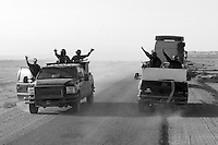 Two teams of private security operators from the British company ArmorGroup greet each other as they meet while escorting supply convoys near Al Asad air base on October 17, 2006.  The coalition forces and civilian administration in Iraq depend heavily on thousands of controversial security contractors to support their reconstruction efforts and military operations.