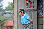 A Maya indigenous woman in the doorway of a store in Victoria 20 de enero, a village of former Guatemalan refugees in Mexico who returned home as a group in 1993, while the country's bloody civil war still raged.