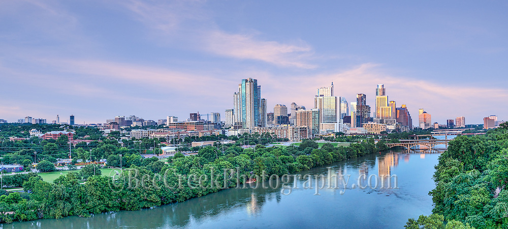 Captured this aerial pano image of the Austin skyline downtown over Lady Bird Lake at sunset.  This image includes all the way to Texas Capital to UT Tower. This cityscape image was a fleeting capture only got these great sky with pink colors for a moment. We loved this view looking down Lady Bird Lake with all the high rise buildings along the shore line and the Lamar, Pfluger, along with First and Congress. We also found out that they had closed down the lake due to flooding upstream while we were shooting, just another day in Texas.