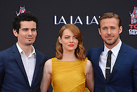 Actors Emma Stone &amp; Ryan Gosling with director Damien Chazelle at the TCL Chinese Theatre, Hollywood, where the stars of La La Land had their hand &amp; footprints set in cement. <br /> December 7, 2016<br /> Picture: Paul Smith/Featureflash/SilverHub 0208 004 5359/ 07711 972644 Editors@silverhubmedia.com