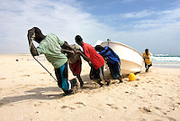 Fisherman pull in their boat in the coastal village of Eyl. The town is a base for local pirates, and piracy has fuelled the local economy.