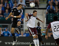 Alan Gordon of Earthquakes battles for the ball in the air against Hunter Freeman of Rapids during the game at Buck Shaw Stadium in Santa Clara, California on August 25th, 2012.   San Jose Earthquakes defeated Colorado Rapids, 4-1.